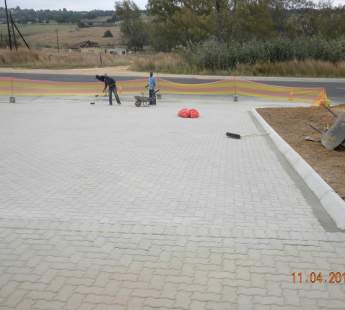 Paving in and finishing sweeping in final plaster sand and cement mix